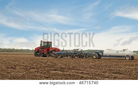 Plowing A Farm Field