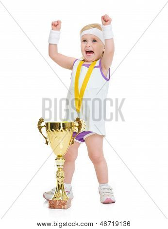 Happy Baby In Tennis Clothes With Medal And Goblet Rejoicing Suc