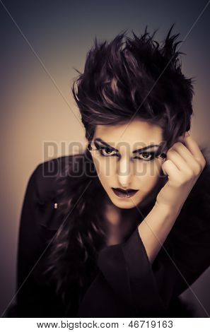 Fashion style photo for young beautiful woman with stylish short hair and intense cosmetic makeup