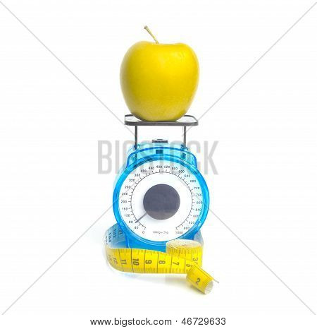 Yellow Apple On Scale