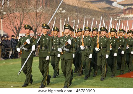 BEIJING - DECEMBER 27: Chinese soldiers are marching training for preparation of the national flag ceremony on December 27, 2011 in Beijing, China. Visitor are watching soldier training.