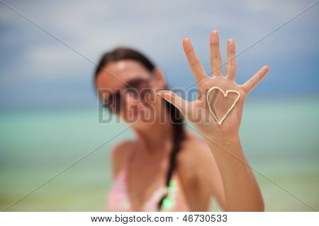 Close-up Of Girl's Hand With Heart On The Palm Painted By Suncream