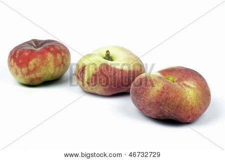 Close up of wild peaches on the white background