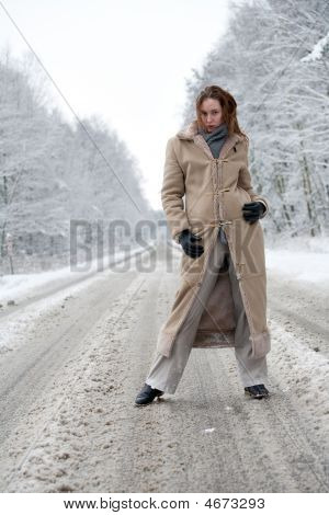 Winter Landscape Woman Standing On A Snowy Road