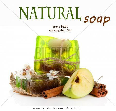 Hand made soap and ingredients for soap making, isolated on white