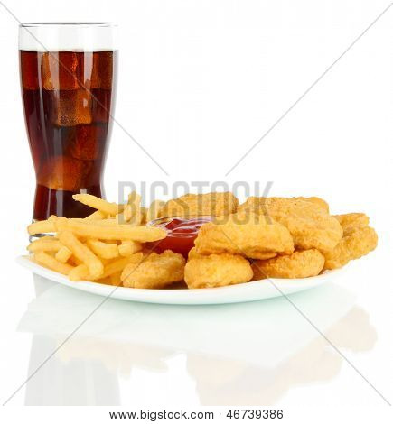 Fried chicken nuggets with french fries,cola and sauce isolated on white