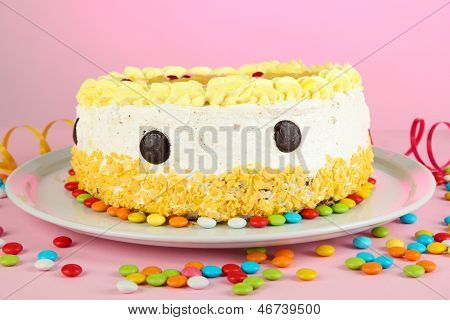 Happy birthday cake, on pink background