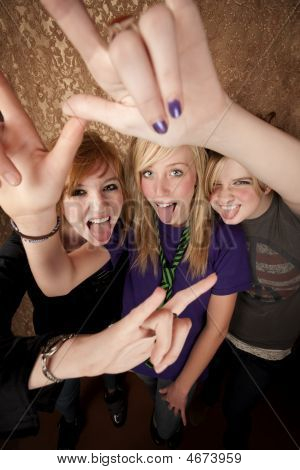 Three Young Girls Making Hand Gestures
