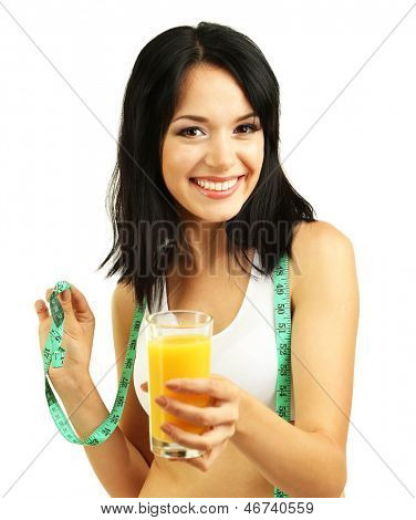 Girl with fresh orange juice and centimeter isolated on white