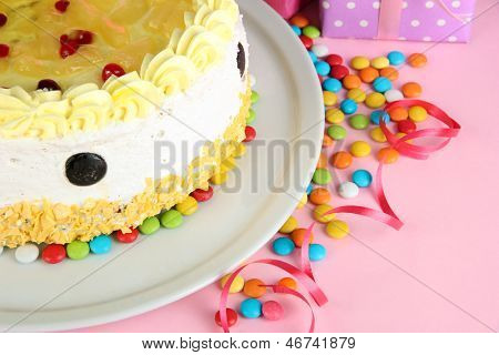 Happy birthday cake and gifts, on pink background