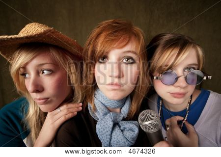 Three Young Girls With Microphone