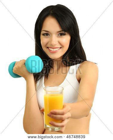 Girl with fresh orange juice and dumbbell isolated on white