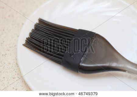 Black Silicone Pastry Brush On White Plate