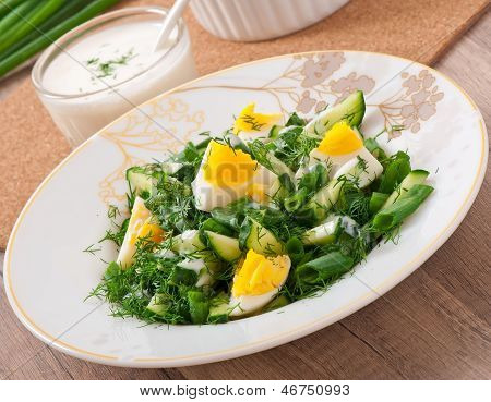salad of boiled eggs, green onions and cucumber with yogurt dressing