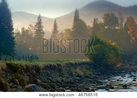 mountain landscape with riverbed in morning light. nature