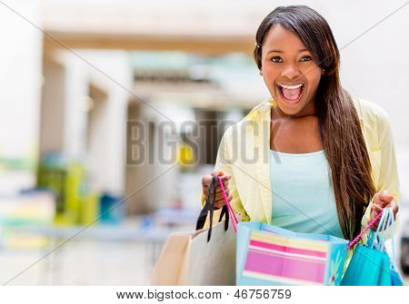 Excited shopping woman looking at her purchases