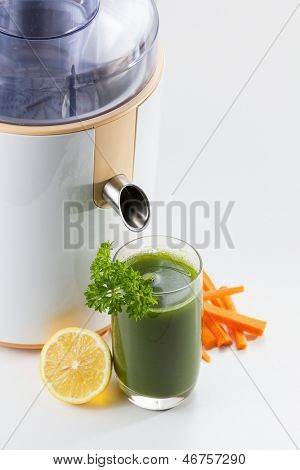 Healthy green vegetable juice with juice extractor