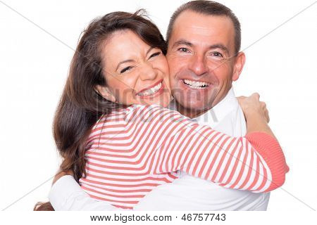Smiling couple in front of white background