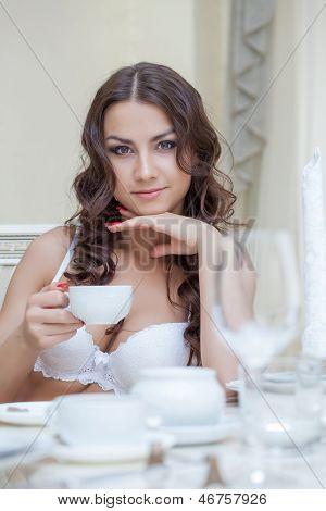 Smiling brunette posing in white brassiere