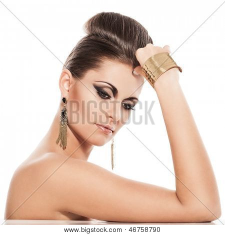 Beautiful young caucasian  woman with evening makeup and hairstyle on a white background