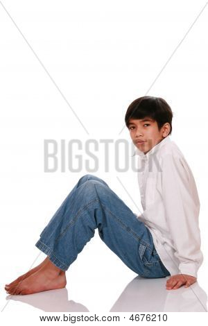 Twelve Year Old Boy Sitting On Floor