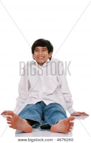 Teen Boy Sitting On Floor
