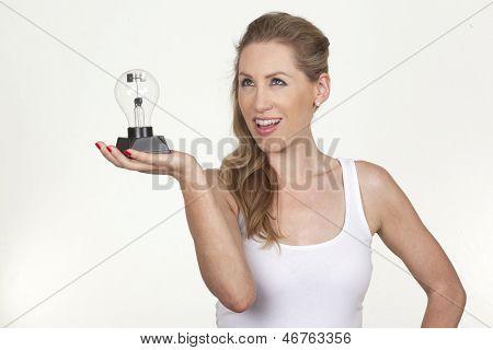 Beautiful Female Model Holding A Bulb