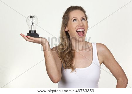 Pretty Female Model Holding Bulb And Laughing