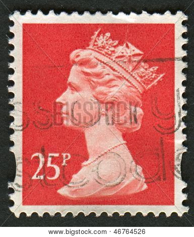 UK-CIRCA 1993: A stamp printed in UK shows image of Elizabeth II is the constitutional monarch of 16 sovereign states known as the Commonwealth realms, in Rose Red, circa 1993.