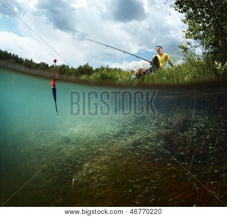 Young smiling man fishing on a green pond's coast with underwater view of weed on a bottom