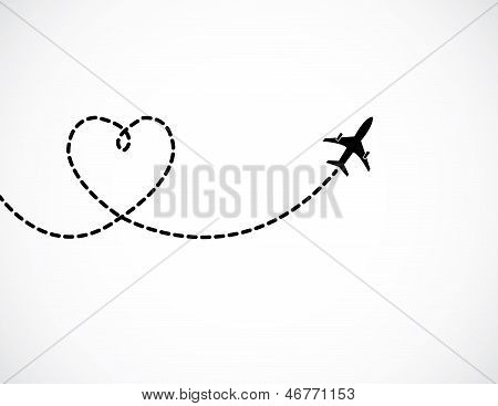A Airplane Flying In The White Sky Leaving Behind A Love Shaped Smoke Trail