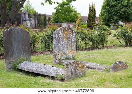 Old Weathered Tombs In Graveyard