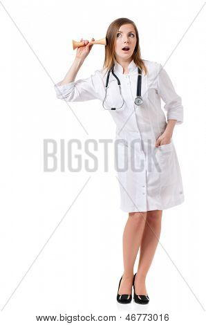 Female doctor holding a wooden stethoscope for listening to baby heart sound, isolated on white background