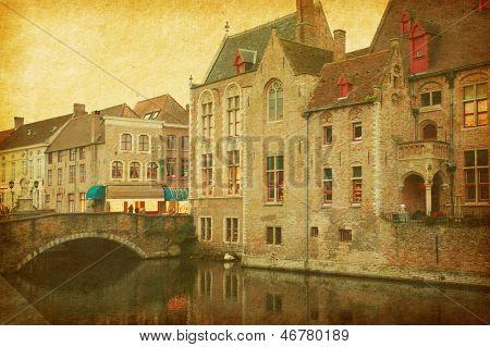Bruges historic centre, Belgium. Photo in retro style. Paper texture.