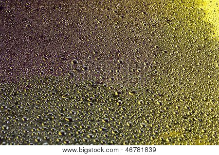 Water drops on gold surface