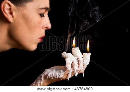 Three Candle Sticks On Fingers Buring Face Blow
