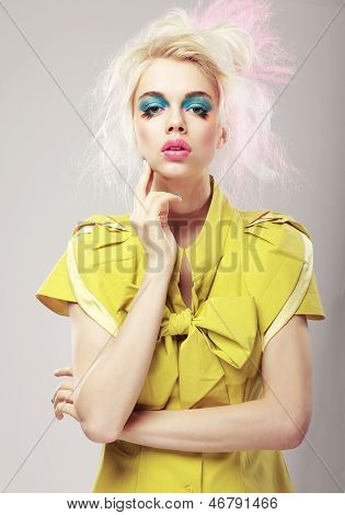 Art Deco. Vivid Blond Hair Woman With  Conspicuous Makeup. Glamor