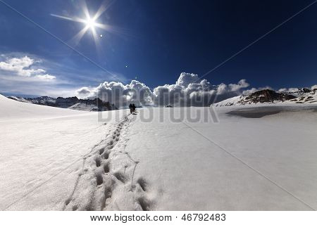 Hikers On Snow Mountains