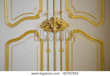 Noble castle door with gilded ornaments