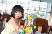foto of girl toy  - Little Asian girl playing with toy portrait - JPG