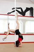 foto of lap dancing  - Young pole dance woman at a training class - JPG