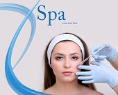 image of lip augmentation  - Young woman receiving plastic surgery injection on her face close up - JPG