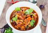 picture of pinto  - Vegetarian chilli with red and white beans close up selective focus - JPG