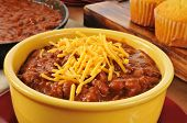 picture of shredded cheese  - A bowl of chili con carne with shredded cheddar cheese - JPG