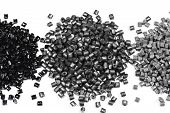 picture of thermoplastics  - heaps of gray metallic polymer resin on white background - JPG