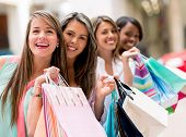 pic of mall  - Happy group of shopping friends smiling at the mall - JPG