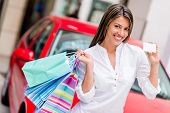 foto of plastic money  - Happy woman shoppping with credit card to win a car - JPG