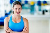 foto of sportive  - Fit woman at the gym looking very happy - JPG