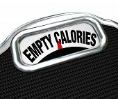 image of obese  - The words Empty Calories on the display of a scale to illustrate the importance of eating nutritional foods for good health instead of junk or fast food such as snacks - JPG