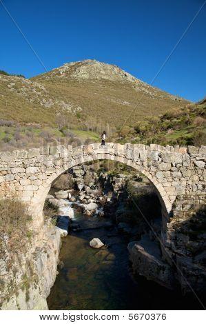 Walking On Ancient Bridge